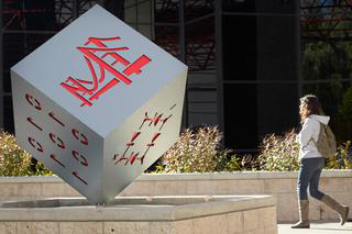 Cube outside of the College of Engineering with a bridge