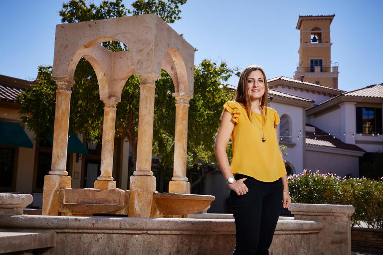 A female student visiting an Italian-themed resort at Lake Las Vegas.